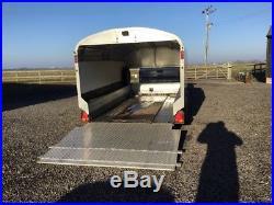 Brian james a seies coverd car trailer