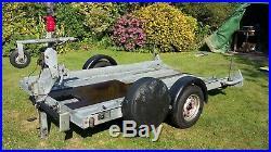 Space saving motorhome small car transporter / Brian James folding pole trailer