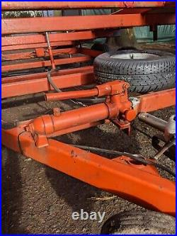 Tilt bed twin axle beavertail car transporter trailer with winch. FITS IN GARAGE